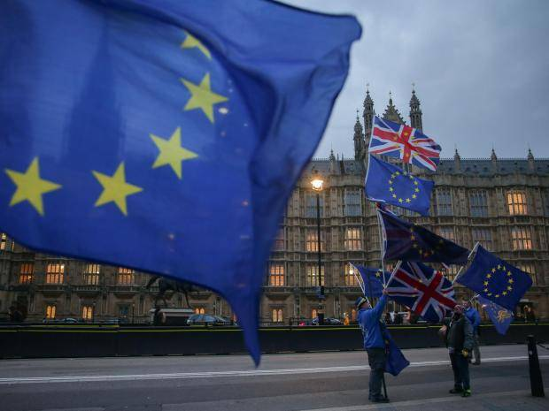 eu flags 3 - UK Brexit negotiating has been 'a shambles' demonstrating 'unpreparedness' and 'a lack of professionalism'